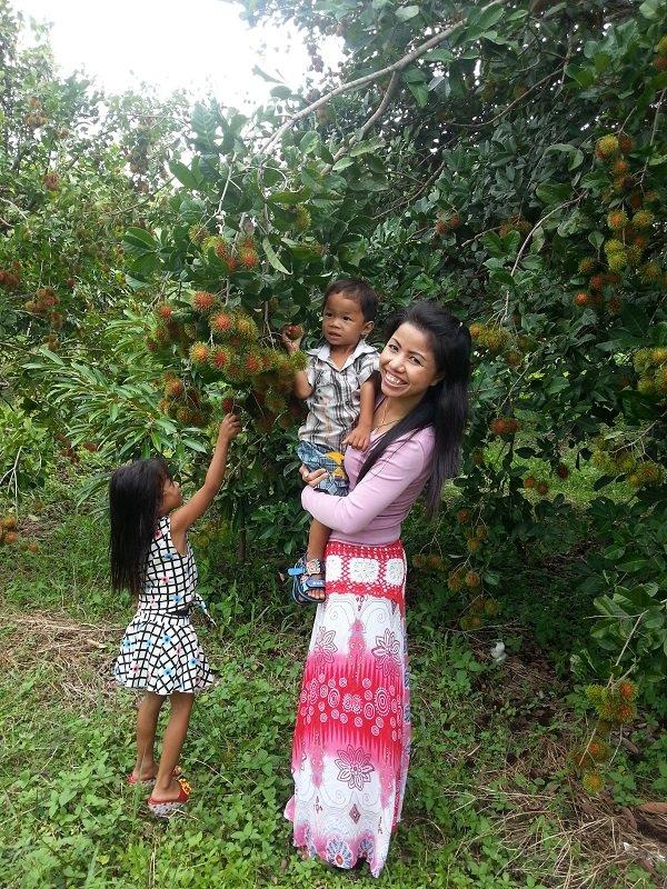 Children picking Rambutan