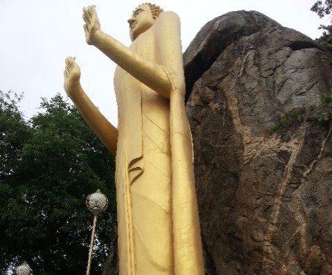 Giant standing Buddha at Wat Khao Lat in Hua Hin