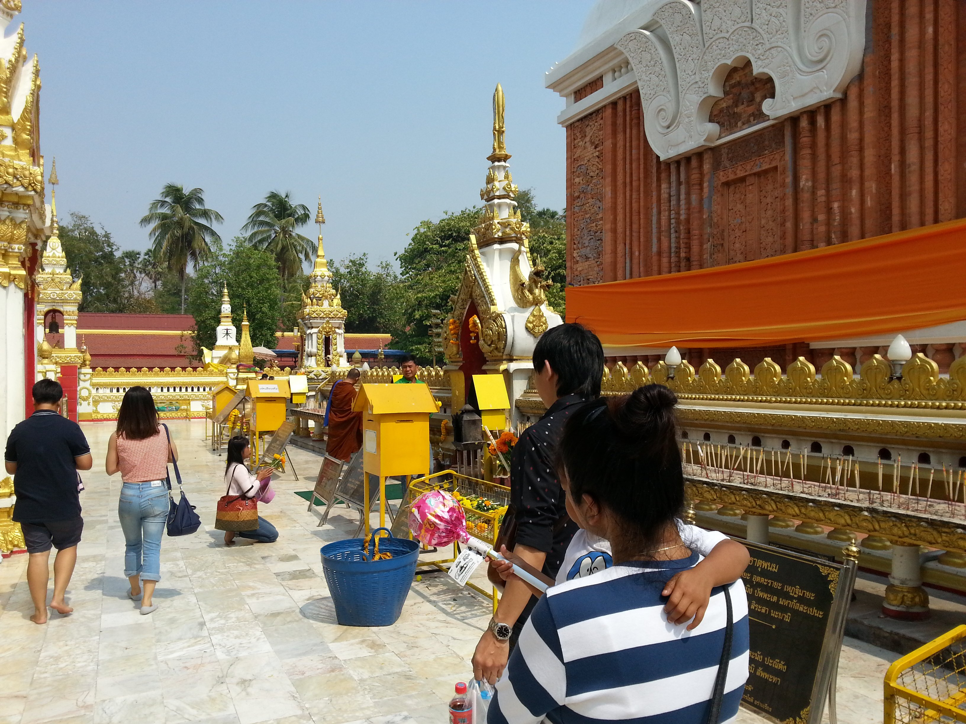 Walking around the chedi at Wat Phra That Phanom is believed to bring good fortune