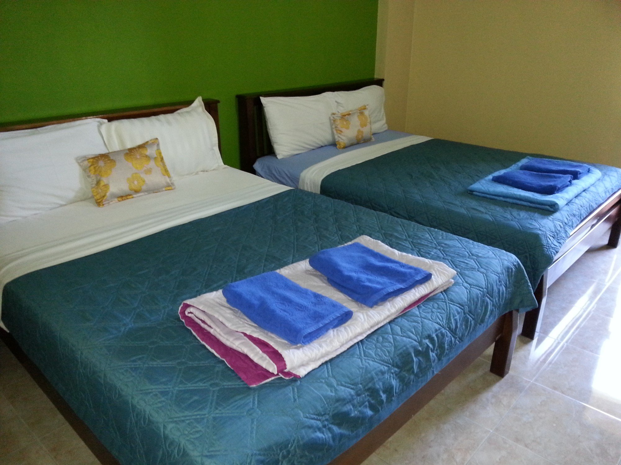 Beds at the Ban Punmanus Guesthouse