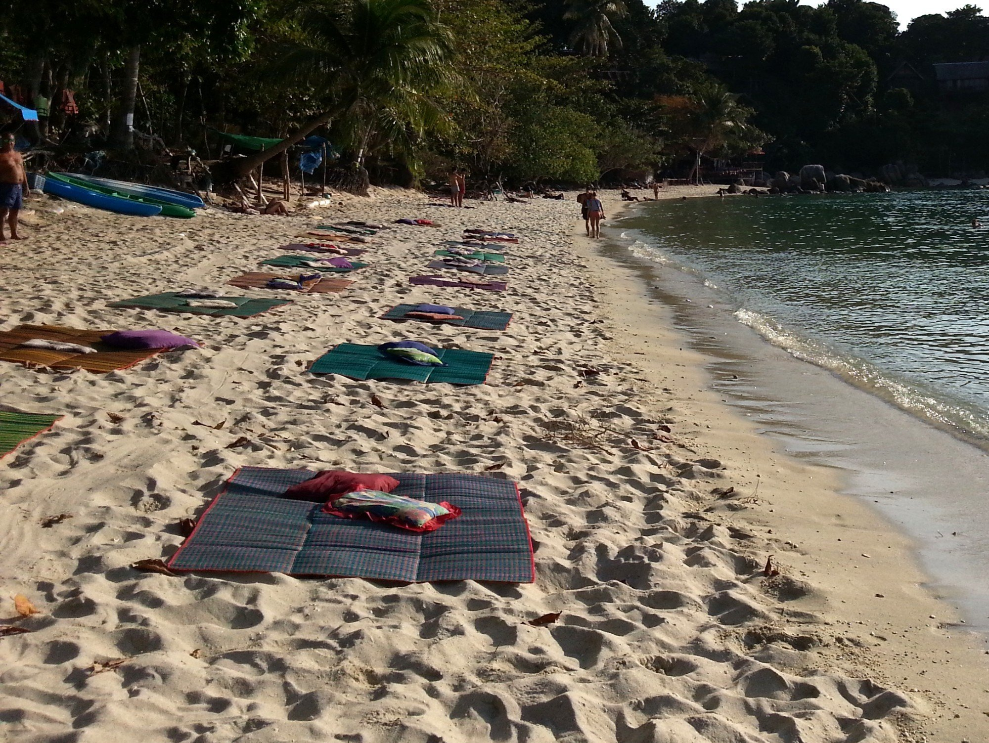 Beach mats laid out for sunset