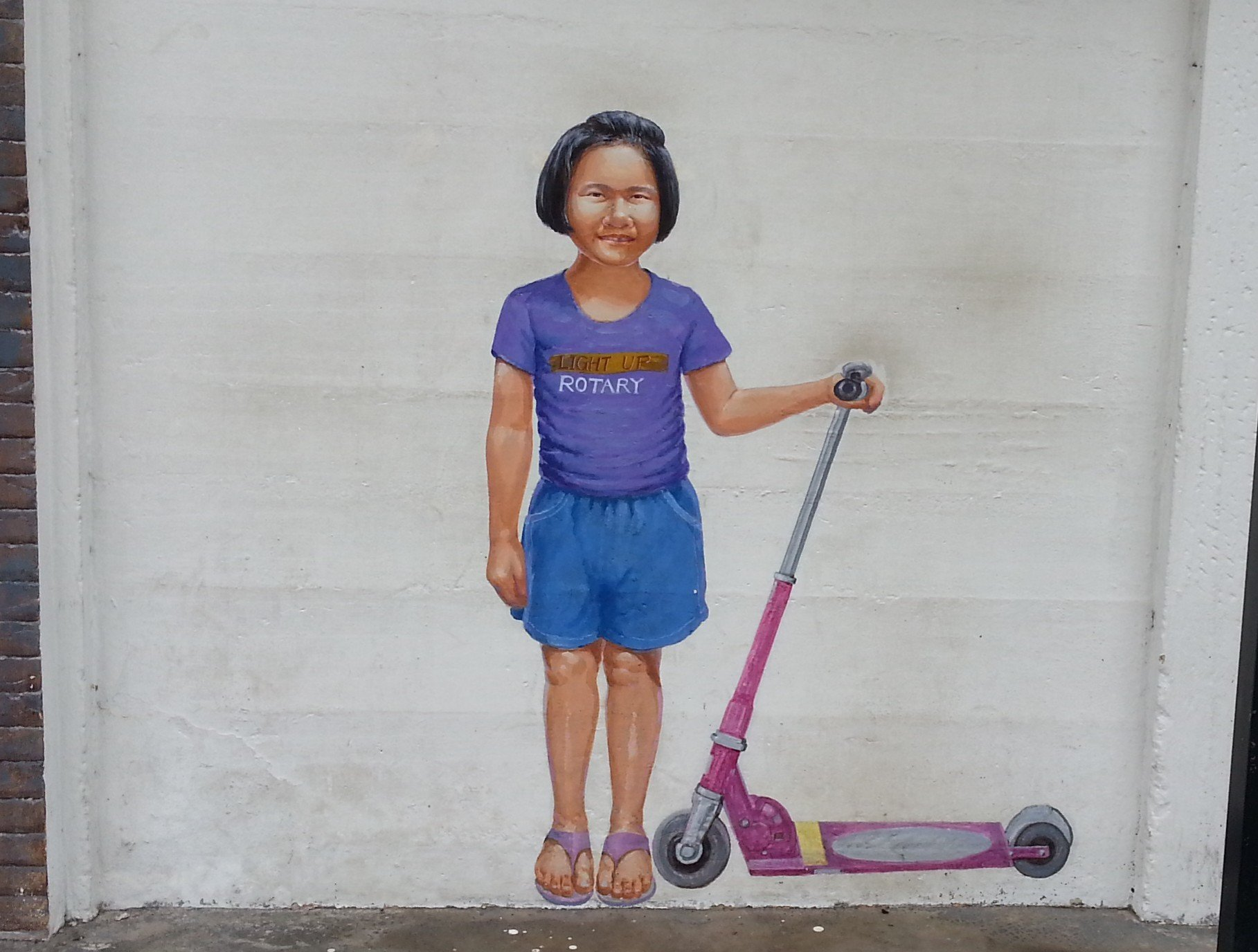 Mural of a local girl on Ratchadamnoen Alley in Trang