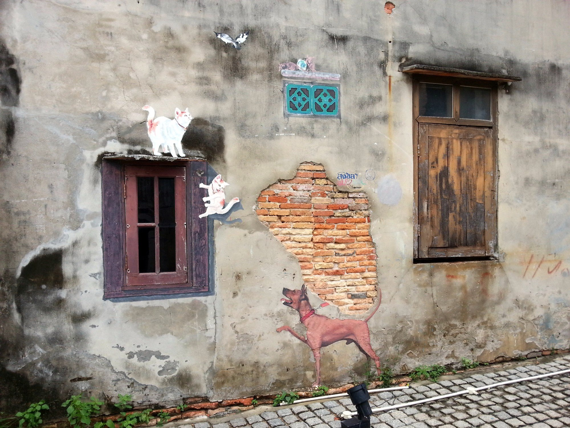 Dog chasing Cats mural in Songkhla
