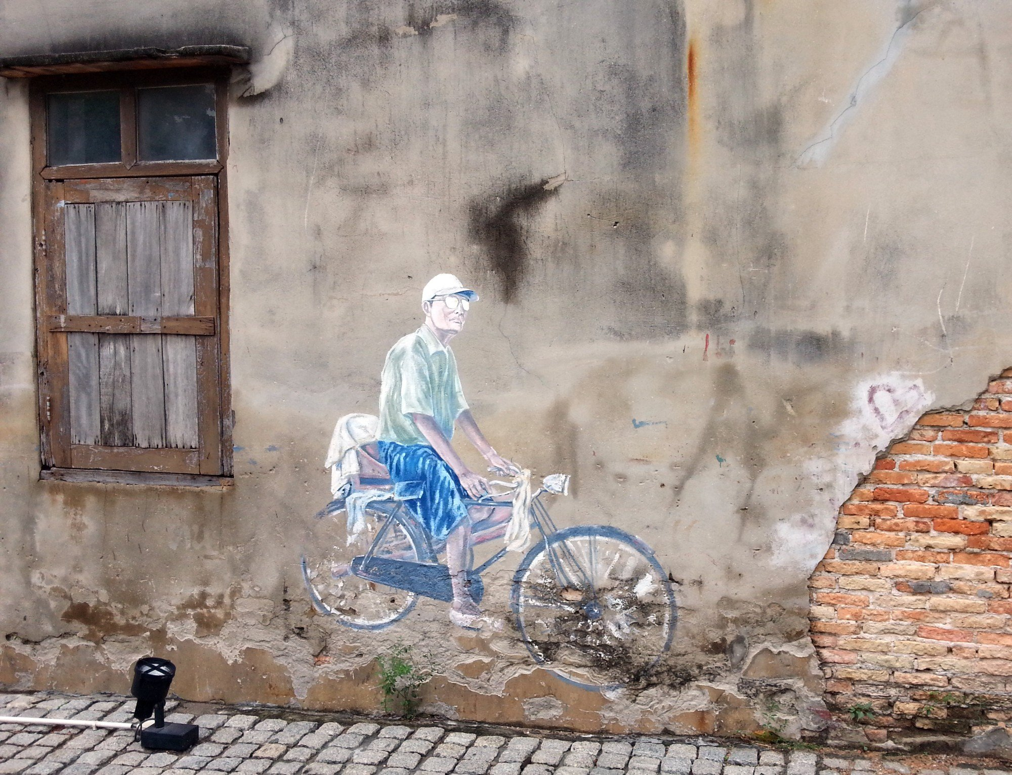Old Man on a Bicycle mural in Songkhla