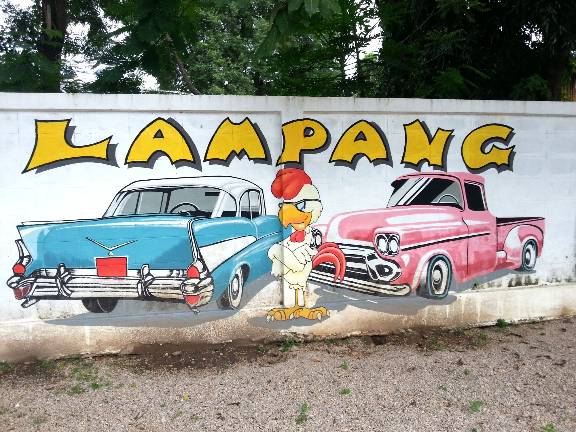 Car owning rooster mural in Lampang
