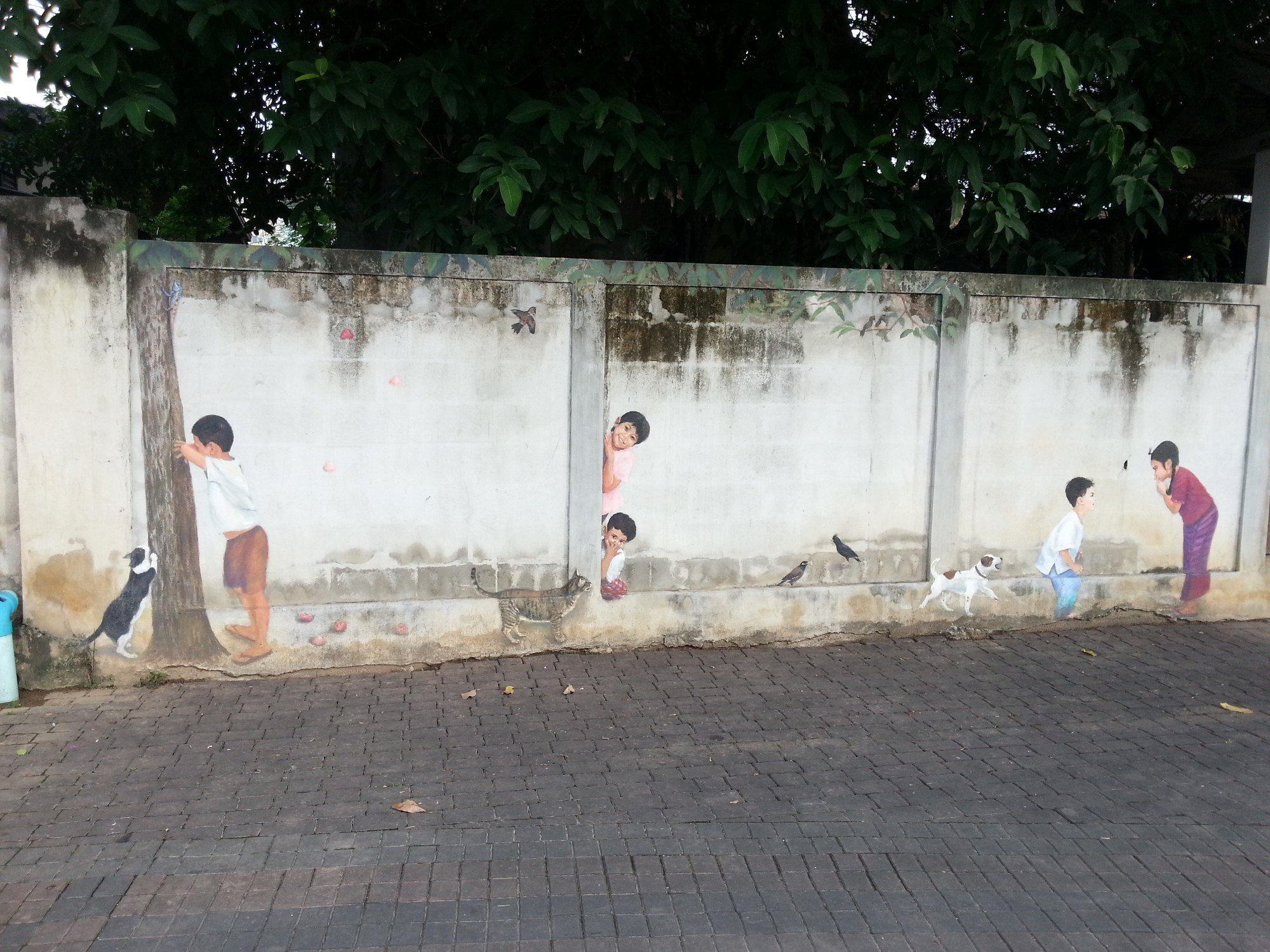 Children and pets mural in Lampang