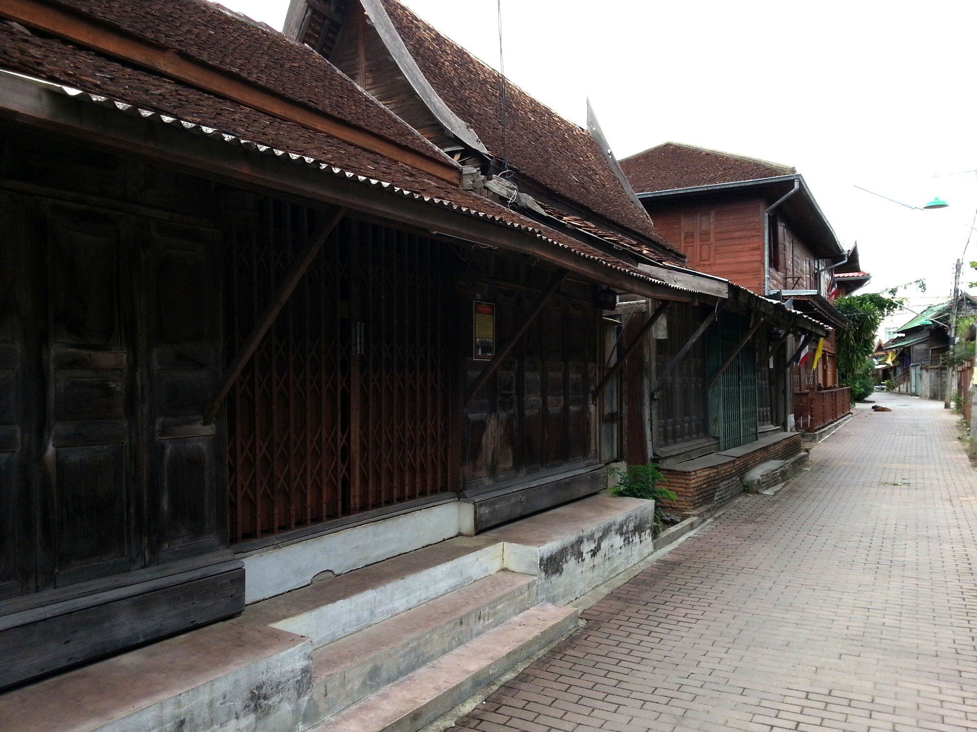 Shop houses with Thai style roofs on Ban Chin Alley