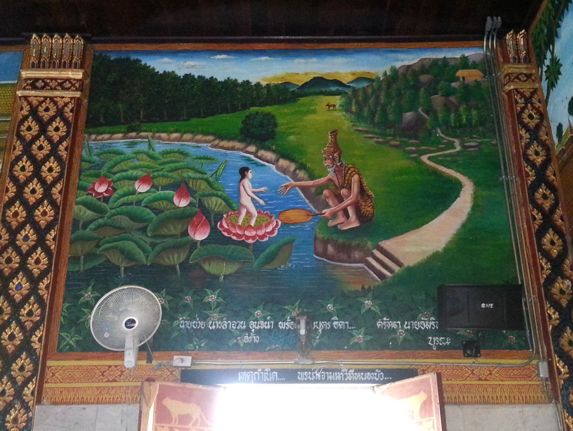 Wall murals depicting scenes from the life of Queen Chammathewi