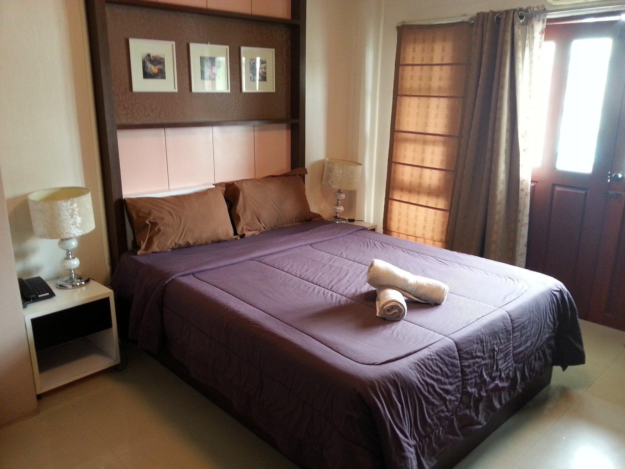 Bed at the Baan Chiang Rai Guest House