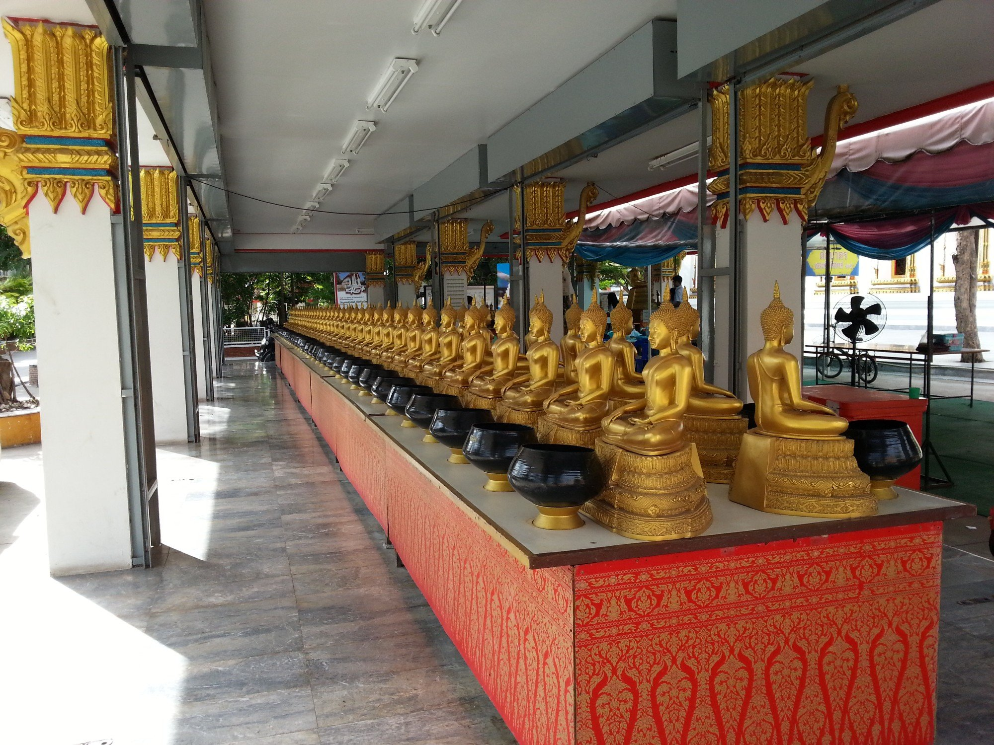 Collection bowls at Wat Nakhon Sawan